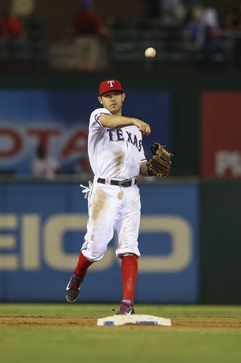 Sep 26, 2013; Arlington, TX, USA; Texas Rangers second baseman Ian Kinsler (5) throws to first base during the game against the Los Angeles Angels at Rangers Ballpark in Arlington. Mandatory Credit: Kevin Jairaj-USA TODAY Sports