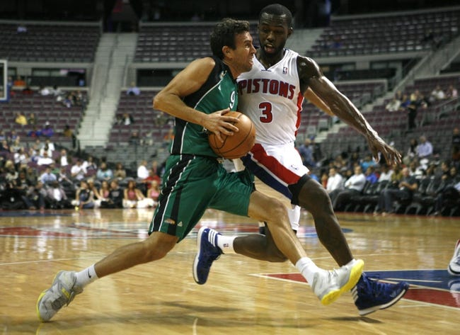 Oct 8, 2013; Auburn Hills, MI, USA; Haifa point guard Moran Roth (9) gets defended by Detroit Pistons guard Rodney Stuckey (3) during the second quarter at The Palace of Auburn Hills. Mandatory Credit: Raj Mehta-USA TODAY Sports