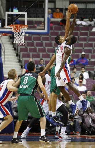 Oct 8, 2013; Auburn Hills, MI, USA; Detroit Pistons guard Rodney Stuckey (3) and Haifa center Alex Chubrevich (7) fight for a jump ball during the second quarter at The Palace of Auburn Hills. Mandatory Credit: Raj Mehta-USA TODAY Sports