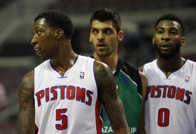Oct 8, 2013; Auburn Hills, MI, USA; Detroit Pistons guard Kentavious Caldwell-Pope (5) looks to his right with Haifa center Alex Chubrevich (7) and Pistons center Andre Drummond (0) in the background during the second quarter at The Palace of Auburn Hills. Mandatory Credit: Raj Mehta-USA TODAY Sports