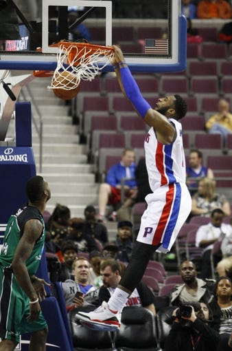 Oct 8, 2013; Auburn Hills, MI, USA; Detroit Pistons center Andre Drummond (0) makes a dunk during the second quarter against Haifa at The Palace of Auburn Hills. Mandatory Credit: Raj Mehta-USA TODAY Sports