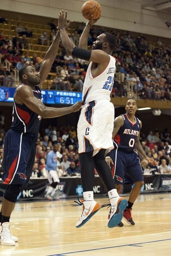 Oct 8, 2013; Asheville, NC, USA;  Charlotte Bobcats center Al Jefferson (25) shoots the ball over Atlanta Hawks power forward Elton Brand (42) during the first half at the U.S. Cellular Center. Mandatory Credit: Jeremy Brevard-USA TODAY Sports