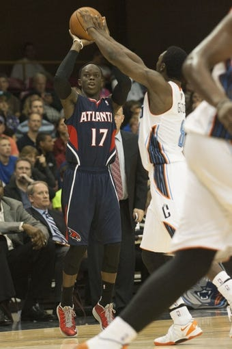 Oct 8, 2013; Asheville, NC, USA;  Atlanta Hawks point guard Dennis Schroder (17) shoots the ball over Charlotte Bobcats shooting guard Ben Gordon (8) during the second half at the U.S. Cellular Center.The Hawks defeated the Bobcats 87-85.  Mandatory Credit: Jeremy Brevard-USA TODAY Sports