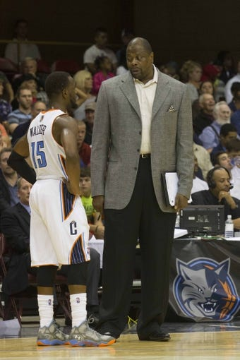 Oct 8, 2013; Asheville, NC, USA; Charlotte Bobcats assistant coach Patrick Ewing talks with point guard Kemba Walker (15) during the second half against the Atlanta Hawks at the U.S. Cellular Center.The Hawks defeated the Bobcats 87-85.  Mandatory Credit: Jeremy Brevard-USA TODAY Sports