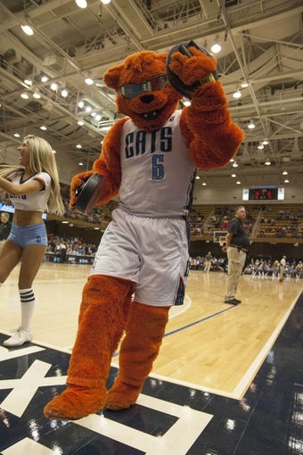 Oct 8, 2013; Asheville, NC, USA;  Charlotte Bobcats mascot Rufus dances during a timeout during the second half against the Atlanta Hawks at the U.S. Cellular Center.The Hawks defeated the Bobcats 87-85.  Mandatory Credit: Jeremy Brevard-USA TODAY Sports
