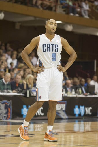 Oct 8, 2013; Asheville, NC, USA; Charlotte Bobcats shooting guard Gerald Henderson (9) stands on the court during the first half of the game against the Atlanta Hawks at the U.S. Cellular Center.The Hawks defeated the Bobcats 87-85.  Mandatory Credit: Jeremy Brevard-USA TODAY Sports