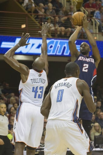 Oct 8, 2013; Asheville, NC, USA;  Atlanta Hawks shooting guard Damien Wilkins (2) shoots the ball over Charlotte Bobcats power forward Anthony Tolliver (43) during the second half at the U.S. Cellular Center.The Hawks defeated the Bobcats 87-85.  Mandatory Credit: Jeremy Brevard-USA TODAY Sports