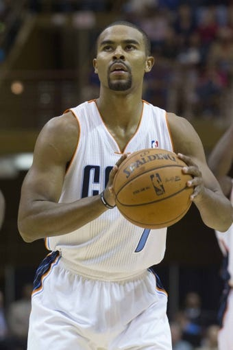 Oct 8, 2013; Asheville, NC, USA; Charlotte Bobcats point guard Ramon Sessions (7) shoots a free throw during the first half against the Atlanta Hawks at the U.S. Cellular Center.The Hawks defeated the Bobcats 87-85.  Mandatory Credit: Jeremy Brevard-USA TODAY Sports