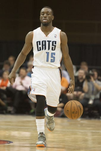 Oct 8, 2013; Asheville, NC, USA; Charlotte Bobcats point guard Kemba Walker (15) brings the ball down the court during the first half against the Atlanta Hawks at the U.S. Cellular Center.The Hawks defeated the Bobcats 87-85.  Mandatory Credit: Jeremy Brevard-USA TODAY Sports