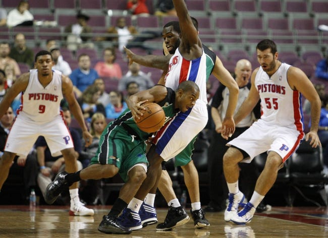 Oct 8, 2013; Auburn Hills, MI, USA; Haifa point guard David Cubillan (10) runs into Detroit Pistons guard Rodney Stuckey (3) during the fourth quarter at The Palace of Auburn Hills. Pistons beat Haifa 91-69. Mandatory Credit: Raj Mehta-USA TODAY Sports