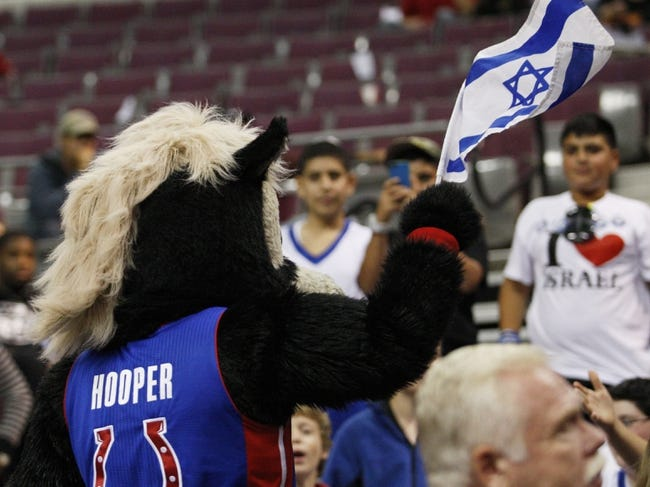 Oct 8, 2013; Auburn Hills, MI, USA; Detroit Pistons mascot Hooper waves an Israeli flag during the fourth quarter against Haifa at The Palace of Auburn Hills. Pistons beat Haifa 91-69. Mandatory Credit: Raj Mehta-USA TODAY Sports