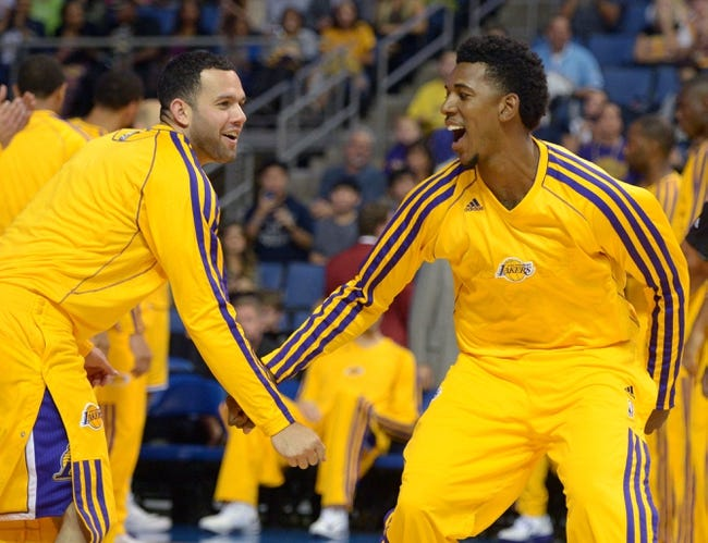 Oct 8, 2013; Ontario, CA, USA; Los Angeles Lakers guards Jordan Farmar (left) and Nick Young react before the game against the Denver Nuggets at Citizens Business Bank Arena. The Lakers defeated the Nuggest 90-88. Mandatory Credit: Kirby Lee-USA TODAY Sports