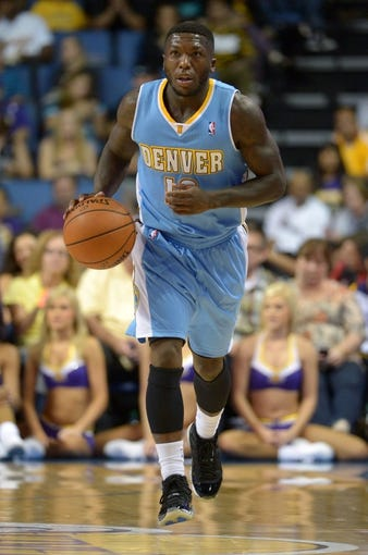 Oct 8, 2013; Ontario, CA, USA; Denver Nuggets guard Nate Robinson (10) dribbles the ball against the Los Angeles Lakers at Citizens Business Bank Arena. The Lakers defeated the Nuggest 90-88. Mandatory Credit: Kirby Lee-USA TODAY Sports
