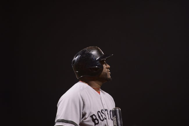 August 19, 2013; San Francisco, CA, USA; Boston Red Sox designated hitter David Ortiz (34) walks to the dugout after striking out during the ninth inning against the San Francisco Giants at AT&T Park. The Red Sox defeated the Giants 7-0. Mandatory Credit: Kyle Terada-USA TODAY Sports