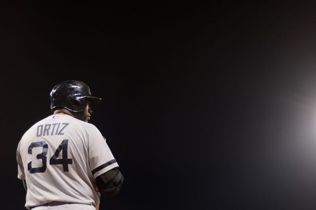 August 19, 2013; San Francisco, CA, USA; Boston Red Sox designated hitter David Ortiz (34) stands on the on-deck circle during the sixth inning against the San Francisco Giants at AT&T Park. The Red Sox defeated the Giants 7-0. Mandatory Credit: Kyle Terada-USA TODAY Sports