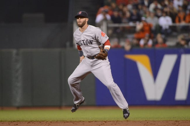 August 19, 2013; San Francisco, CA, USA; Boston Red Sox second baseman Dustin Pedroia (15) jumps during the third inning against the San Francisco Giants at AT&T Park. The Red Sox defeated the Giants 7-0. Mandatory Credit: Kyle Terada-USA TODAY Sports