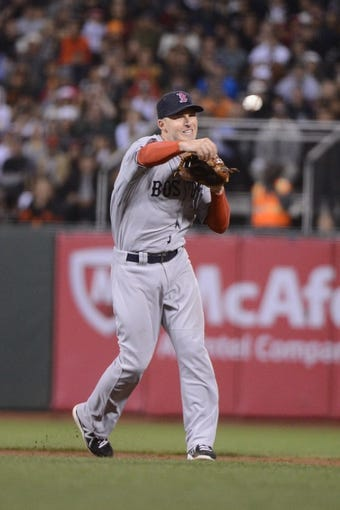 August 19, 2013; San Francisco, CA, USA; Boston Red Sox shortstop Stephen Drew (7) throws the baseball to first base during the fifth inning against the San Francisco Giants at AT&T Park. The Red Sox defeated the Giants 7-0. Mandatory Credit: Kyle Terada-USA TODAY Sports