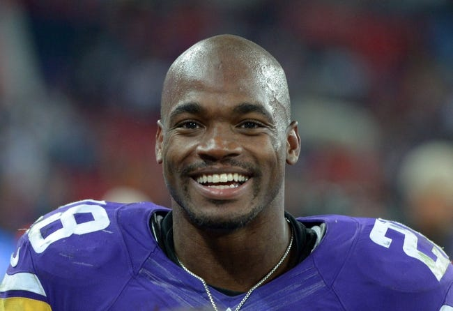 Sep 29, 2013; London, UNITED KINGDOM; Minnesota Vikings running back Adrian Peterson (28) reacts after the NFL International Series game against the Pittsburgh Steelers at Wembley Stadium. The Vikings defeated the Steelers 34-27. Mandatory Credit: Kirby Lee-USA TODAY Sports