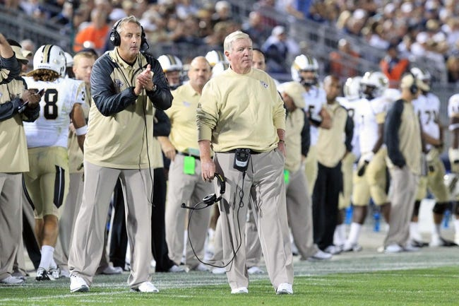 Sep 14, 2013; University Park, PA, USA; Central Florida Knights head coach George O'Leary (center) looks on from the sideline during the fourth quarter against the Penn State Nittany Lions at Beaver Stadium. Mandatory Credit: Matthew O'Haren-USA TODAY Sports