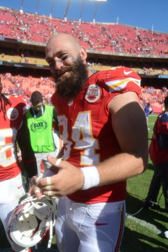 Sep 29, 2013; Kansas City, MO, USA;  Kansas City Chiefs tight end Sean McGrath (84) talks to player on the field after the game against the New York Giants at Arrowhead Stadium. The Chiefs won 31-7. Mandatory Credit: Denny Medley-USA TODAY Sports