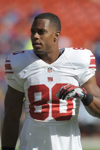 Sep 29, 2013; Kansas City, MO, USA; New York Giants wide receiver Victor Cruz (80) warms up before the game against the Kansas City Chiefs at Arrowhead Stadium. The Chiefs won 31-7. Mandatory Credit: Denny Medley-USA TODAY Sports