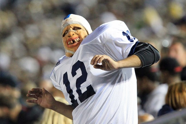 Sep 14, 2013; University Park, PA, USA; A masked Penn State Nittany Lions fan dances during the fourth quarter against the Central Florida Knights at Beaver Stadium. Mandatory Credit: Matthew O'Haren-USA TODAY Sports