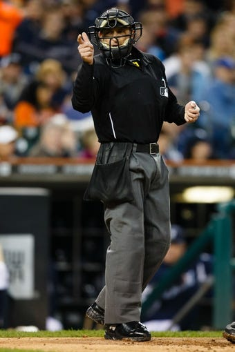 Sep 16, 2013; Detroit, MI, USA; MLB umpire Chris Guccione calls a strike during the game between the Detroit Tigers and the Seattle Mariners at Comerica Park. Mandatory Credit: Rick Osentoski-USA TODAY Sports
