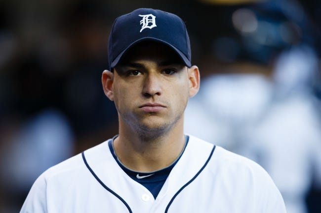 Sep 16, 2013; Detroit, MI, USA; Detroit Tigers shortstop Jose Iglesias (1) in the dugout against the Seattle Mariners at Comerica Park. Mandatory Credit: Rick Osentoski-USA TODAY Sports