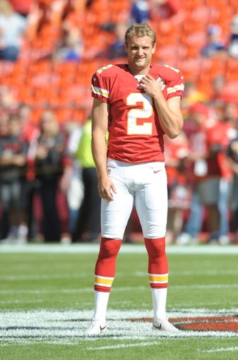 Sep 29, 2013; Kansas City, MO, USA; Kansas City Chiefs punter Dustin Colquitt (2) warms up before the game against the New York Giants at Arrowhead Stadium. The Chiefs won 31-7. Mandatory Credit: Denny Medley-USA TODAY Sports
