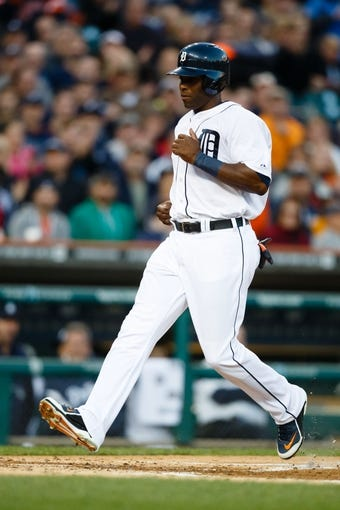 Sep 16, 2013; Detroit, MI, USA; Detroit Tigers right fielder Torii Hunter (48) scores a run against the Seattle Mariners at Comerica Park. Mandatory Credit: Rick Osentoski-USA TODAY Sports
