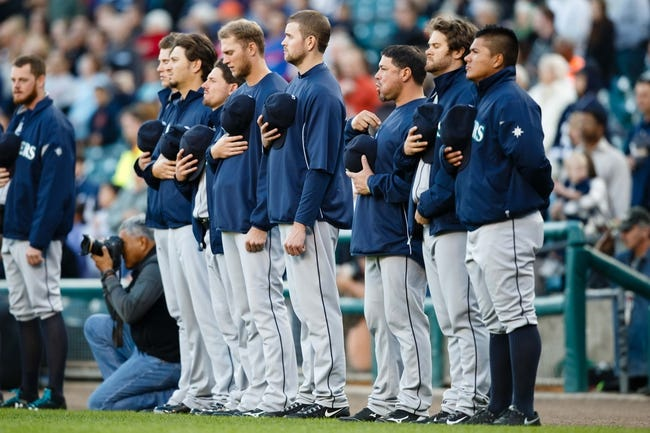 Sep 16, 2013; Detroit, MI, USA; Seattle Mariners players during the national anthem before the game against the Detroit Tigers at Comerica Park. Mandatory Credit: Rick Osentoski-USA TODAY Sports