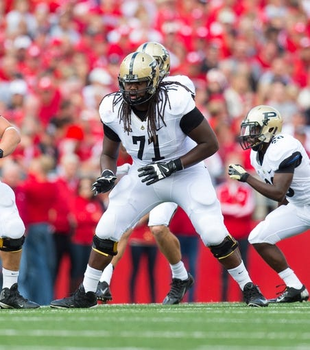 Sep 21, 2013; Madison, WI, USA;  Purdue Boilermakers offensive lineman Devin Smith (71) during the game against the Wisconsin Badgers at Camp Randall Stadium. Wisconsin defeated Purdue 41-10.  Mandatory Credit: Jeff Hanisch-USA TODAY Sports