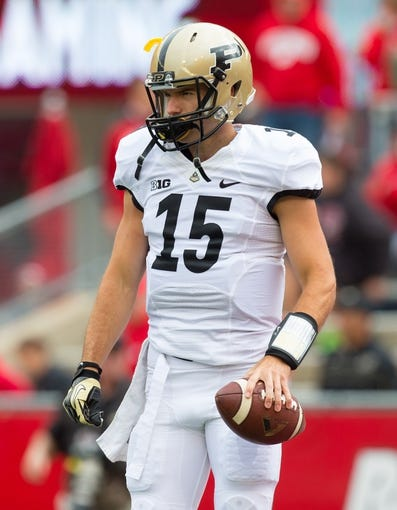 Sep 21, 2013; Madison, WI, USA;  Purdue Boilermakers quarterback Rob Henry (15) during warmups prior to the game against the Wisconsin Badgers at Camp Randall Stadium. Wisconsin defeated Purdue 41-10.  Mandatory Credit: Jeff Hanisch-USA TODAY Sports