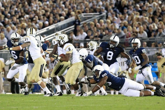 Sep 14, 2013; University Park, PA, USA; Central Florida Knights wide receiver Rannell Hall (6) runs the ball on a punt return during the third quarter against the Penn State Nittany Lions at Beaver Stadium. Central Florida defeated Penn State 34-31. Mandatory Credit: Matthew O'Haren-USA TODAY Sports