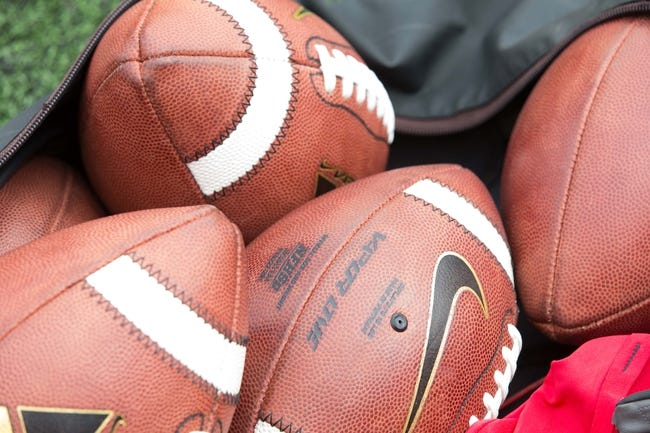 Sep 21, 2013; Madison, WI, USA;  Footballs rest in a bag during warmups prior to the game between the Purdue Boilermakers and Wisconsin Badgers at Camp Randall Stadium. Wisconsin defeated Purdue 41-10.  Mandatory Credit: Jeff Hanisch-USA TODAY Sports
