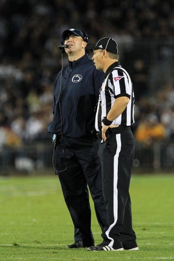 Sep 14, 2013; University Park, PA, USA; Penn State Nittany Lions head coach Bill O'Brien waits for a call on a review during the third quarter against the Central Florida Knights at Beaver Stadium. Central Florida defeated Penn State 34-31. Mandatory Credit: Matthew O'Haren-USA TODAY Sports