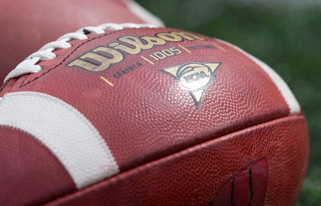 Sep 21, 2013; Madison, WI, USA;  A Wilson football during warmups prior to the game between the Purdue Boilermakers and Wisconsin Badgers at Camp Randall Stadium. Wisconsin defeated Purdue 41-10.  Mandatory Credit: Jeff Hanisch-USA TODAY Sports