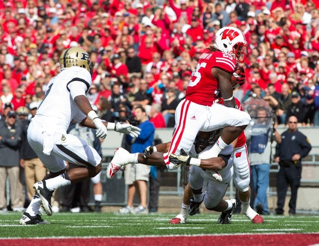 Sep 21, 2013; Madison, WI, USA;  Wisconsin Badgers running back Melvin Gordon (25) during the game against the Purdue Boilermakers at Camp Randall Stadium. Wisconsin defeated Purdue 41-10.  Mandatory Credit: Jeff Hanisch-USA TODAY Sports