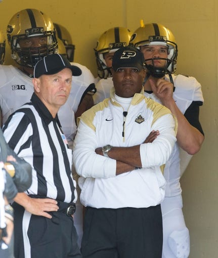 Sep 21, 2013; Madison, WI, USA;  Purdue Boilermakers head coach Darrell Hazell stands before the team prior to the game against the Wisconsin Badgers at Camp Randall Stadium. Wisconsin defeated Purdue 41-10.  Mandatory Credit: Jeff Hanisch-USA TODAY Sports