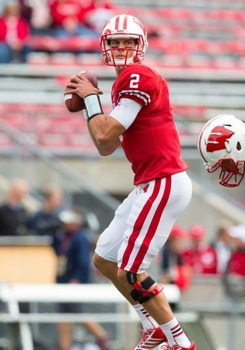 Sep 21, 2013; Madison, WI, USA;  Wisconsin Badgers quarterback Joel Stave (2) during warmups prior to the game against the Purdue Boilermakers at Camp Randall Stadium. Wisconsin defeated Purdue 41-10.  Mandatory Credit: Jeff Hanisch-USA TODAY Sports