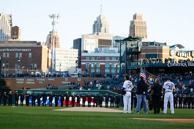 Sep 16, 2013; Detroit, MI, USA; Detroit Tigers relief pitcher Darin Downs (34) and left fielder Nick Castellanos (30) during the national anthem before the game against the Seattle Mariners at Comerica Park. Mandatory Credit: Rick Osentoski-USA TODAY Sports