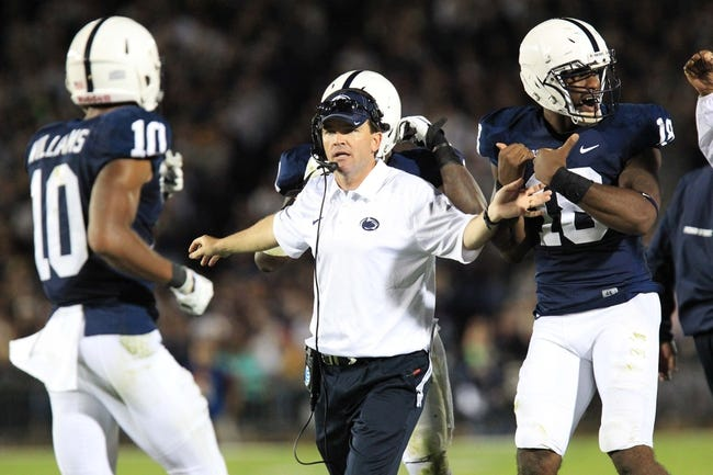 Sep 14, 2013; University Park, PA, USA; Penn State Nittany Lions defensive coordinator John Butler instructs from the sideline during the third quarter against the Central Florida Knights at Beaver Stadium. Central Florida defeated Penn State 34-31. Mandatory Credit: Matthew O'Haren-USA TODAY Sports