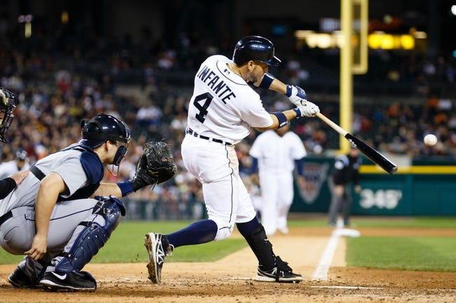 Sep 16, 2013; Detroit, MI, USA; Detroit Tigers second baseman Omar Infante (4) at bat against the Seattle Mariners at Comerica Park. Mandatory Credit: Rick Osentoski-USA TODAY Sports