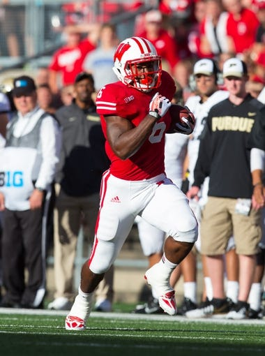 Sep 21, 2013; Madison, WI, USA;  Wisconsin Badgers running back Corey Clement (6) during the game against the Purdue Boilermakers at Camp Randall Stadium. Wisconsin defeated Purdue 41-10.  Mandatory Credit: Jeff Hanisch-USA TODAY Sports