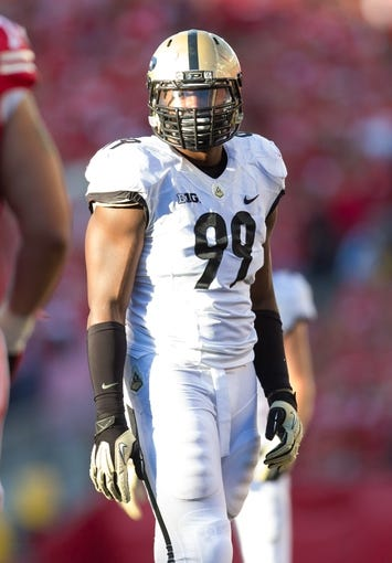Sep 21, 2013; Madison, WI, USA;  Purdue Boilermakers defensive end Ryan Russell (99) during the game against the Wisconsin Badgers at Camp Randall Stadium. Wisconsin defeated Purdue 41-10.  Mandatory Credit: Jeff Hanisch-USA TODAY Sports