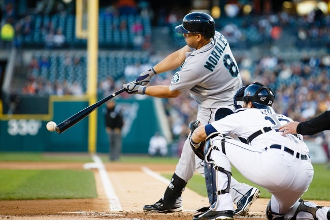 Sep 16, 2013; Detroit, MI, USA; Seattle Mariners designated hitter Kendrys Morales (8) at bat in front of Detroit Tigers catcher Alex Avila (13) at Comerica Park. Mandatory Credit: Rick Osentoski-USA TODAY Sports