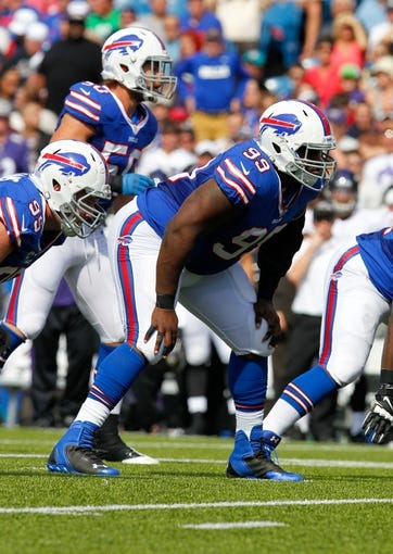 Sep 29, 2013; Orchard Park, NY, USA; Buffalo Bills defensive tackle Marcell Dareus (99) waits for the snap against the Baltimore Ravens at Ralph Wilson Stadium. Mandatory Credit: Timothy T. Ludwig-USA TODAY Sports