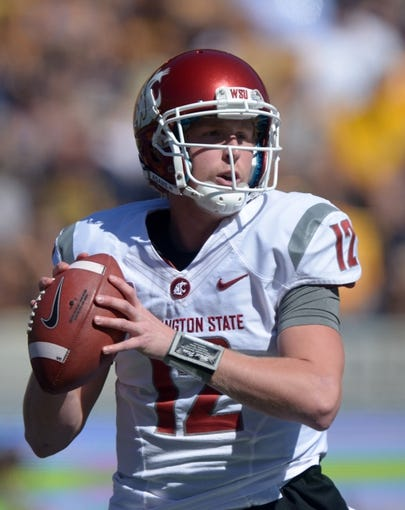Oct 5, 2013; Berkeley, CA, USA; Washington State Cougars quarterback Connor Halliday (12) throws a pass against the California Golden Bears at Memorial Stadium. Washington State defeated California 44-22. Mandatory Credit: Kirby Lee-USA TODAY Sports