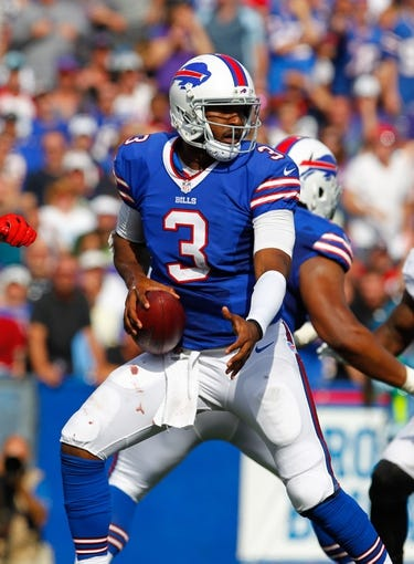 Sep 29, 2013; Orchard Park, NY, USA; Buffalo Bills quarterback EJ Manuel (3) looks to make a pass against the Baltimore Ravens at Ralph Wilson Stadium. Bills beat Ravens 23 to 20.  Mandatory Credit: Timothy T. Ludwig-USA TODAY Sports