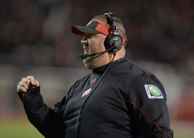 Oct 3, 2013; Salt Lake City, UT, USA; Utah Utes offensive line coach Dan Finn reacts during the game against the UCLA Bruins at Rice-Eccles Stadium. UCLA defeated Utah 34-27. Mandatory Credit: Kirby Lee-USA TODAY Sports